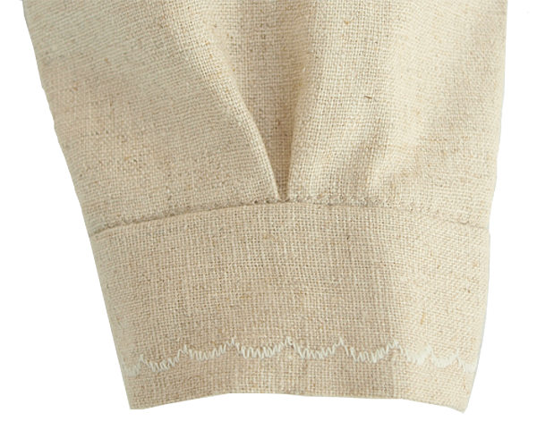 Minimundus dopklänning av oblekt naturtyg lin/bomull detalj manschett